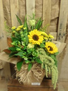 Lovely in yellow. Sunflowers are the star in this beautiful bouquet! Created at Florist ilene