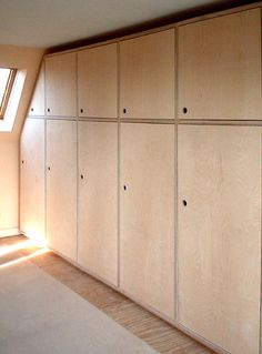 'Weaver' Plywood fitted wardrobes.