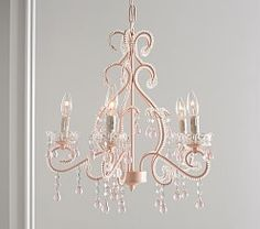 Like a vision from a fairytale, our grand chandelier is bedecked in beads and faceted glass crystals. The scrolled arms hold candle-shaped lights for a romantic glow. DETAILS THAT MATTER Pottery Barn Chandelier, Girls Chandelier, Rose Gold Chandelier, Nursery Chandelier, Painted Chandelier, Acrylic Chandelier, Flush Mount Chandelier, Pendant Chandelier, Girls Room Chandeliers