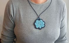 Hand-embroidered fashion accessories. Apparel, pendants, earrings, necklaces with folk motifs.