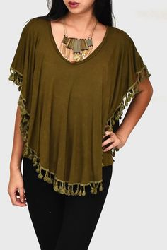 This flowy loose fitting blouse with fringe edges is sure to make you feel like the master of your dreams. Dress it up or dress is down, you will the magic no matter what.   Dreamcatcher Blouse  Clothing - Tops - Short Sleeve Clothing - Tops - Blouses & Shirts Seattle , Washington
