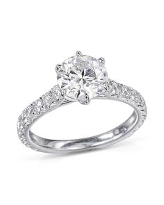 A platinum ring with diamonds along of the ring. The round center diamond is carats while the diamonds on the outside of the ring are CTW. Diamond Rings, Diamond Engagement Rings, Wedding Engagement, Wedding Bands, Thing 1, Gia Certified Diamonds, Platinum Ring, Ring Designs, White Gold