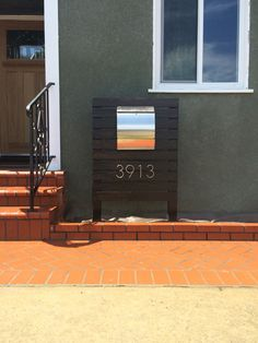 Modern Mailbox. Did it ourselves! $95 worth of redwood, a $60 stainless steel locking mailbox, and $32 worth of raised lettering and voila!