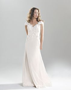 Lillian West Style 6390 - Soft English net V-neckline over a slim jersey A-line gown with dreamy V-back. Unique beaded cotton Venice lace and stretch Jersey lining create a soft look for any outdoor venue.