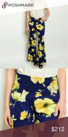 'YELLOW ROSE' Floral flared legged pants Navy blue with floral print wide legged pants.  100%polyester -wide legged-elastic waist band Brand new without tags Pants Wide Leg