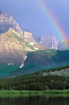 Rainbow over Swiftcurrent Lake, Glacier National Park, Montana, United States.