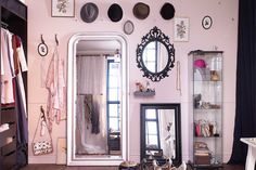 Make your room the fairest of them all and hang multiple mirrors to create a feature wall.