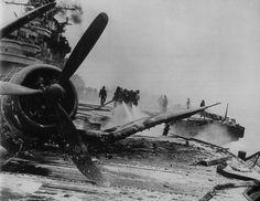 F4U Corsair burned out on USS Hancock (CV-19) after a kamikaze attack off Okinawa - 7th April 1945