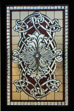 """This window is called the Sullivan Window. This design is based off a L. Sullivan design. Beveled glass contributes to most of this window. It also incorporates some stained glass as well as a few jewels. The bevels in this window are hand cut and beveled by Bogenrief Studios. Each bevel goes through a five-stage process to create this exquisite look. Lead came is used in this window to create a more linear look. The bevels are made out of 5/16"""" starfire plate glass."""