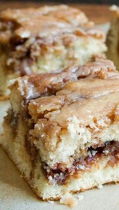 Cinnamon Roll Cake - It's not only made from scratch but so ridiculously easy to make! Everything comes together so quickly and no special equipment is needed. The base is a delicious yellow butter cake with a perfect moist and delicate crumb. Melts in your mouth! The cinnamon filling is incredible and as soon as you make it – you will want to put it on everything!