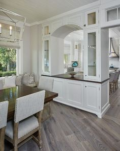 Flooring is white Oak. Classic Gambrel-Style Shingle Home