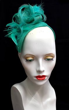Jade green feather and sinamay fascinator teardrop shape