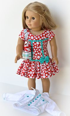 This adorable casual outfit features a dress made from a Melody Valerie Pattern. It is created in a red and white print with tiny aqua dots in each flower. The bodice and side seams are edged with an aqua dot bias, as well as the waistline. A small bow of the same fabric sits at the right side. It closes in the back with an invisible zipper.  The white denim jacket is made from a Liberty Jane pattern. It features lots of top stitching in aqua. Tiny aqua buttons highlight the front of the…