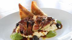 Roast pheasant is as close to a signature dish as The Finery offers in St. Charles, reports Chicago Tribune's Phil Vettel. Thick, crispy-skinned slices of pheasant breast arrive on a nest-shaped pile of risotto, with a little pesto and pheasant stock surrounding it. (E. Jason Wambsgans / Chicago Tribune)