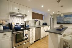 Scott McGillivray, host of HGTV's Income Property, helped homeowners remodel the space into this beautiful kitchen featuring Formica® laminate.