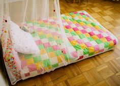 diy kiddo floor bed with batting around the wood parts to make it softer.