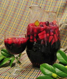 Holiday Sangria with pomegranates and cranberries.  Sounds fabulous