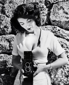 Pin-up photographer and model Bunny Yeager c. 1950's    Presumably this is the Bettie-Page-eye view. I'm smiling!