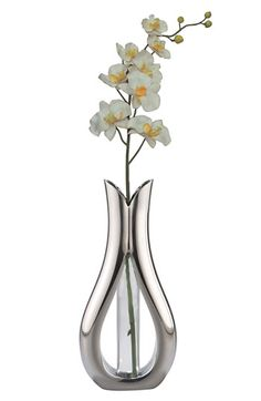 Free shipping and returns on Nambé 'Tulip' Bud Vase with Silk Orchid at Nordstrom.com. A handcrafted, tulip-shaped vase in gleaming alloy metal is designed with a cutout center, revealing the slim glass bud vase within.