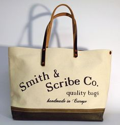 """Hand dyed cotton canvas tote bag - natural colored with jungle green leather strap ● Size: 15 cm x 36 cm x 45 cm ●  5,9"""" x 14,2"""" x 17,7"""" ● In case of order, please contact us with the following e-mail address: info@smithandscribeco.com ● #cottoncanvas #totebag #handdyedcanvas #vintagebag #1920's #1930's #1940's #copperrivet #italianleather #bag #handmadebag Hipster Bag, Scribe, Green Leather, Handmade Bags, Italian Leather, Canvas Tote Bags, Cotton Canvas, Reusable Tote Bags, Street"""