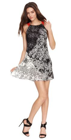 This easy trapeze dress is perfect for dancing the night away! Available at Ali-Ro.com