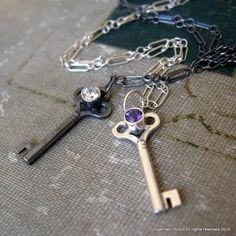 Sterling Silver Key pendant with Amethyst