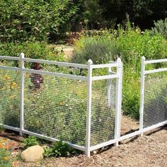 LOVE THIS FENCE!!! (Around garden) Cheap and easy from Home Depot... SnapFence Modular Vinyl Snap Together Fence Corner Rail Connectors (12-Box)-VFE-1-B12 at The Home Depot