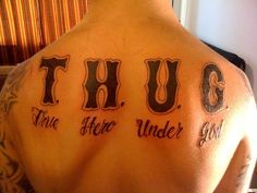 25 Arresting Thug Life Tattoo Designs - SloDive Best 3d Tattoos, God Tattoos, Life Tattoos, Body Art Tattoos, Thug Life Tattoo, Gangster Tattoos, Full Sleeve Tattoos, Calligraphy Alphabet, Tattoo Designs