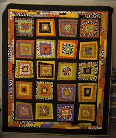 Halloween Quilt-the use of black fabric makes the blocks appear to float. Great idea