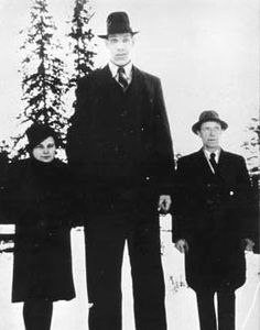 Väinö Myllyrinne 8'3″  Myllyrinne was born in Finland in 1909. At one point he was officially the world's tallest man. At the age of 21 he was 7 feet 3.5 inches tall, and weighed 31 stone. He experienced another growth spurt after that which took him to his final height of 8 feet 3 inches. He is considered to be the tallest soldier in history as he was in the Finnish army. He died in 1963.