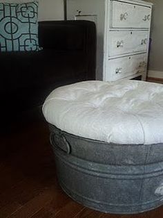 Ottoman made from a galvanized tub, round piece of wood, stuffing, and fabric