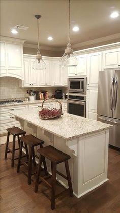 Trim on cabinets & boxed in refrigerator Counter height Saddle Stools stained Kona. New Kitchen Cabinets, Kitchen Redo, Kitchen Ideas, Kona Kitchen, Kitchen Backsplash, Off White Kitchen Cabinets, Design Kitchen, Cupboards, Kitchen Faucets