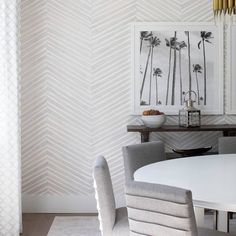 Modern dining room complete with round table and super comfy chairs...perfectly suited to this fun and creative family of four. #designingthenewpalmbeach