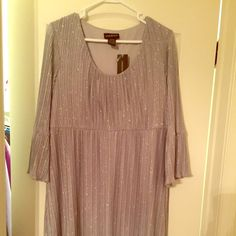 NWT Sparkly empire waist dress Looks adorable on! Very sparkly. Got on a whim and never had occasion to wear it. Lane Bryant Dresses Midi