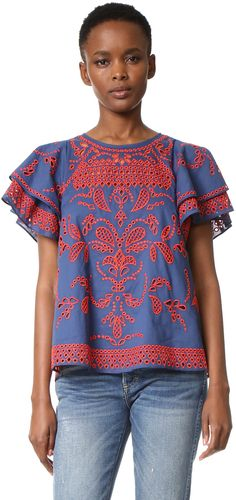 Blue top with flowy sleeves and red embroidery detail. Parker Mara Top