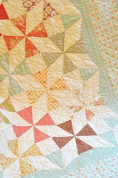 such pretty colours in this pin wheel quilt