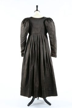 A chocolate brown silk 'Quaker' dress, circa 1818.