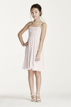 Dress her up in this adorable short chiffon dress!   COMING SOON!  Chiffon sheath features slightsweetheart neckline and spaghetti straps.  Short chiffon skirt with cascading front ruffle.  Fully lined. Zipper back. Imported. Dry clean only.  Compliments perfectly with bridesmaids styles F14847 and W18040.