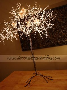 Metal tree with lighting and candles - outside of the tent/reception area?