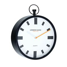 The smaller Spotlight comes with a black metal case and fob, and has large, black, blocky markers on a white dial, with a white hour hand and a brightly contrasting orange minute hand that lightens an otherwise severe, station-clock atmosphere - altogether a vividly modern and energetic piece.  The Spotlight is exclusively designed in the UK for the London Clock Company's Pop collection, and features our advanced energy-saving Japanese mechanism.  Delivered to you in its own beautiful Gift…