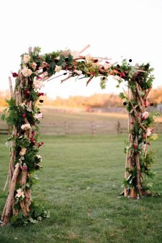 Rustic wedding decor idea: a wood ceremony arch consisting of branches, greenery and jewel toned flowers. |  Sterlingbrook Farm Events in Pittstown, NJ