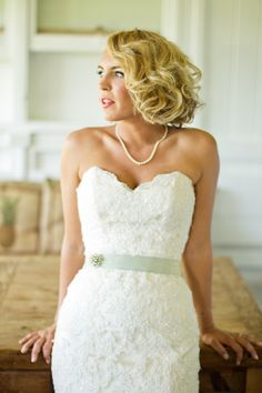 sweetheart neckline & pearls & classic hair do. Bride getting ready. Photo by Mike Larson Photography