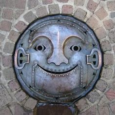 A manhole cover found outside of Tokyo photographed by Joshua Williams. Apparently manhole cover art is fairly common on the streets of Japan. via examiner