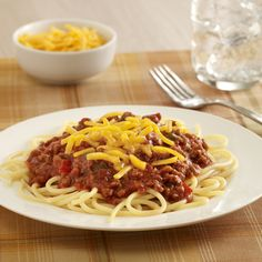Sloppy Joe Topped Spaghetti: Sloppy Joes meat mixture with some tomato sauce becomes an easy sauce recipe to serve over spaghetti with shredded cheese for a family friendly main dish