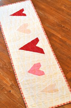 "Free Pieced Heart Table Runner..It's a fun little table runner and you could totally make different hearts in different sizes and get the similar results! I added white to each 6 1/2"" block to make this Table Runner right around 10"" x 33"" in overall size."