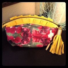 "Anthropolgie clutch Cute fruit inspired clutch with yellow leather ruffled trim & tassel. Gold hardware, zip closure, tons of space for a clutch . Excellent condition! Only flaw is a few slight marks on 3 of the tassels. Not noticeable unless looking for it.  Measures 8""x6"".  bundles. Anthropologie Bags Clutches & Wristlets"