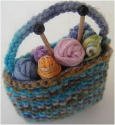 This miniature knitting bag can be completed in an afternoon and makes an excellent ornament or gift for a knitting friend. It's also a gre...