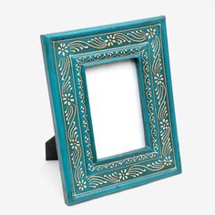 @Overstock - Add a dash of exotic to any photo with this blue mango wood photo frame. Hand-painted for a truly unique finish, it perfectly showcases your treasured pictures with a chic silhouette that doesn't overwhelm the main attraction.  http://www.overstock.com/Worldstock-Fair-Trade/Light-Blue-Mango-Wood-Photo-Frame-India/7482018/product.html?CID=214117 $29.81