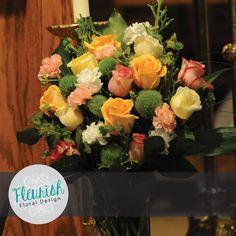 Accent Arrangement by Fleurish Floral Design | Green Pitt, Blupleurum, Bear Grass, Lycopodium, Green Trick Dianthus, Creme de la Creme Roses, Peach Roses, Pink Roses, White Carnations, and Pink Carnations