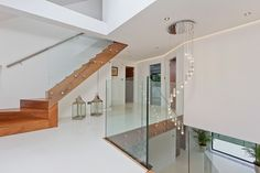 Timber stringer with solid timber landing.  Glass balustrade.